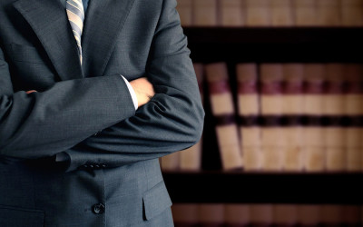 Attorney dictating for legal transcription by virtual assistant